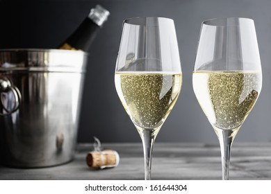 Two glasses of Champagne and Cooler, selective focus