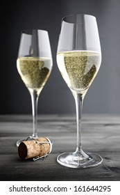 Two glasses of Champagne and Cork, selective focus