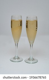 two glasses of champagne isolated on white fizz