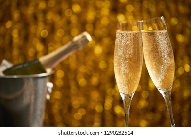 Two glasses of champagne with lights in the background., very shallow depth of fiel