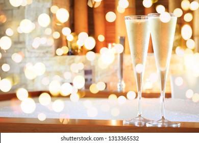 Two glasses of champagne near hot tub. Valentines background. Romance concept. Horizontal, bold festive bokeh