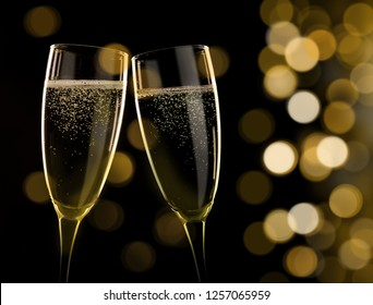 Two glasses of champagne on blured background