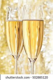 Two glasses of champagne on bokeh background for celebration