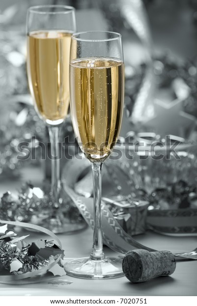 two glasses of champagne on silver background - abstract