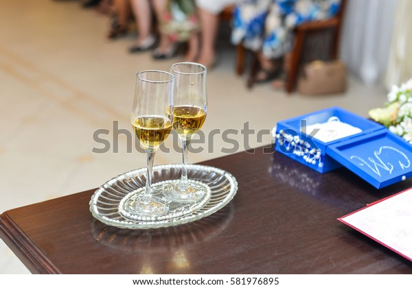 two glasses with champagne on table