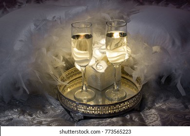Two glasses of champagne. Romantic room arrangement for a date