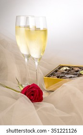 Two Glasses of Champagne, Single Red Rose and a Box of Chocolates, Ready for Valentines Day