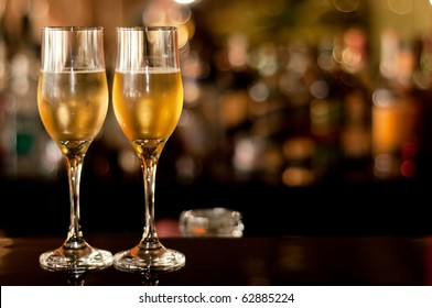 Two glasses of champagne waiting to be served by guests in a restaurant, new year's eve.