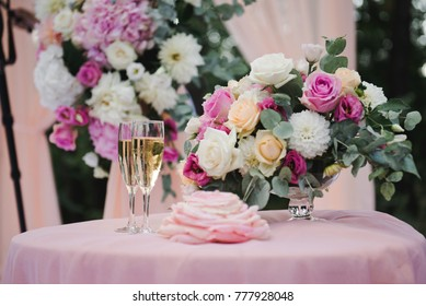 Two glasses of champagne at the wedding ceremony. Wedding ceremony. Beautiful table decorations for wedding ceremony