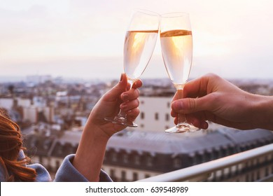 two glasses of champagne or wine, couple dating concept, romantic celebration of engagement or anniversary