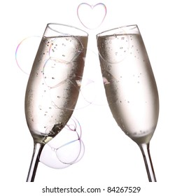 two glasses of chilled champagne with a beautiful heart shaped bubble.