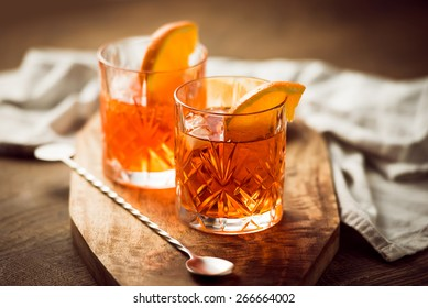 Two glasses of cocktail with orange slice