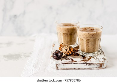 Two Glasses of Date Milkshake with Cinnamon, copy space for your text