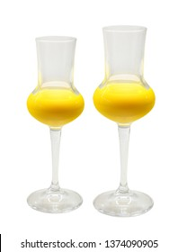 Two glasses of egg liqueur isolated on white background
