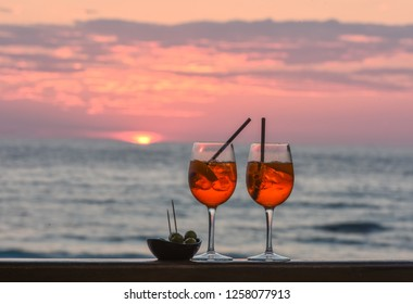 Two glasses of the famous Italian cocktail  spritz  against the background of sunset