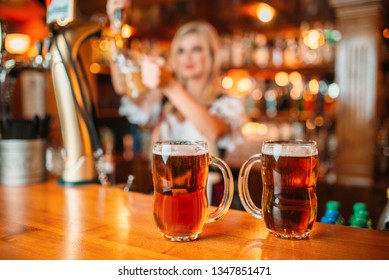 Two glasses of fresh beer on counter, octoberfest