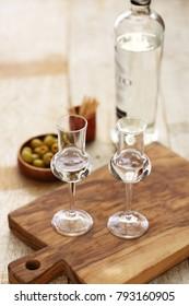 two glasses of  Grappa bianca, italian digestif, grape-based pomace brandy