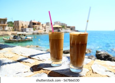 Two glasses of Greek frappe by the sea in Gerolimenas, Mani, Peloponnese