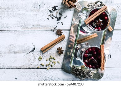 Two glasses of hot mulled wine with spices, top view with copy space