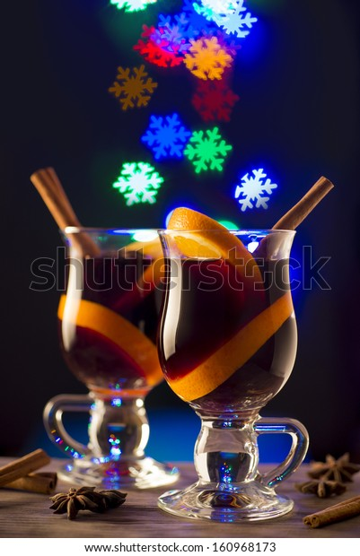 Two glasses of hot wine on snowflake bokeh background
