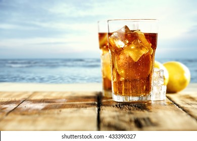 two glasses of ice tea lemon and ice cubes