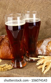 two glasses of kvass with bread on canvas background close-up