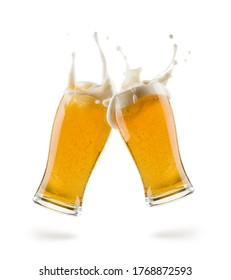 two glasses of lager beer bumping on white background with shadow