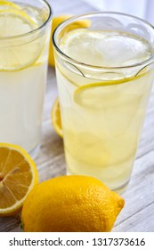 Two glasses of lemonade on a wood surface