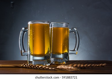 Two glasses with light beer on a gray background. Beer Festival.