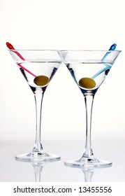 Two glasses of martini with olives