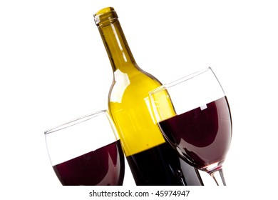 Two glasses of merlot and wine bottle isolated on white.