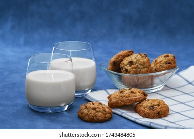Two glasses of milk and homemade cookies