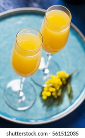 Two glasses with mimosa cocktail (cave plus orange juice)
