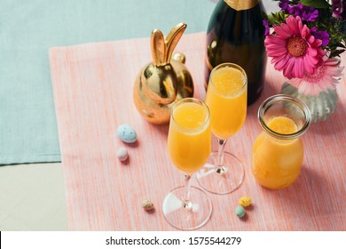 Two glasses of mimosa cocktail (champagne with orange juice). Easter decoration