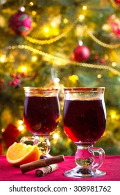 Two glasses of mulled wine with Christmas tree in background
