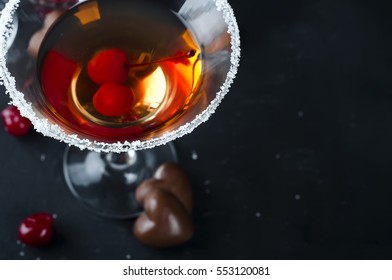 Two glasses on a black background concrete