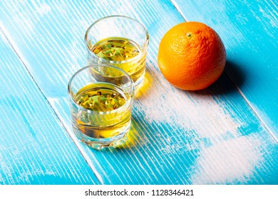 two glasses on the table and orange fruit, appetizer and booze modest