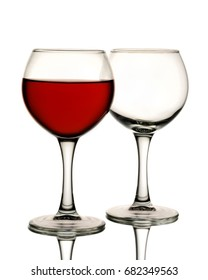 Two glasses one of which is filled with red wine and the other empty is isolated on a white background. wineglass and wine.