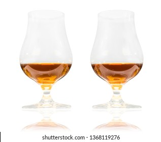 Two glasses of premium alcohol (rum, cognac, whiskey) isolated on white background