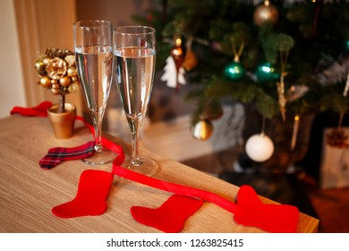 Two glasses of prosecco on a Christmas decorated table