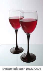 Two glasses of red beverage