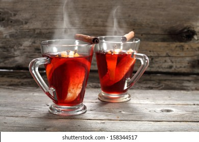 two glasses of red hot drink