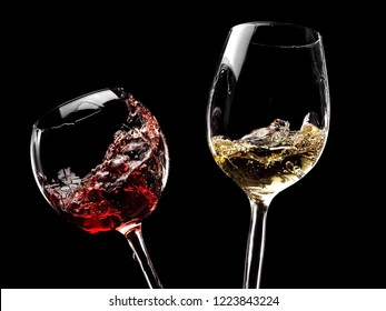 Two glasses with red and white wine plash on black background