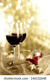 Two glasses of Red Wine and Christmas Ornaments, selective focus