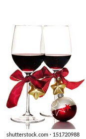 Two glasses of red wine and Christmas ornaments,  isolated on white
