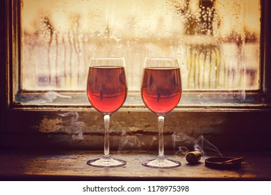 Two glasses of red wine. Concept: love, meeting