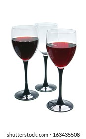 Two glasses of red wine and empty glass. Isolated on white background