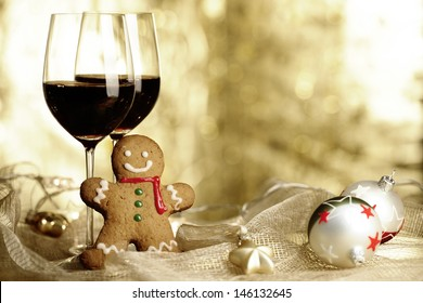 Two glasses of Red Wine, Gingerbread Man and Christmas Ornaments
