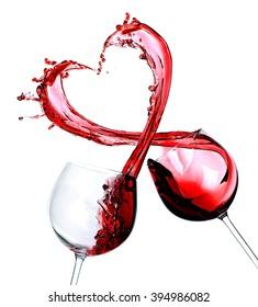 Two glasses of red wine. Heart Splash