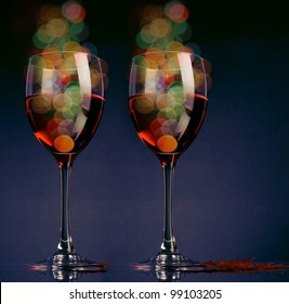Two glasses of red wine with light.